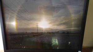 On December 21, 2012, I witnessed magic in the sky - a rainbow around the sun - something I had never seen before.  It was amazing, and I couldn't understand why no one else driving along seemed to see it.  I stopped on Old School Road near Creditview Road and captured this amazing phenomenon.